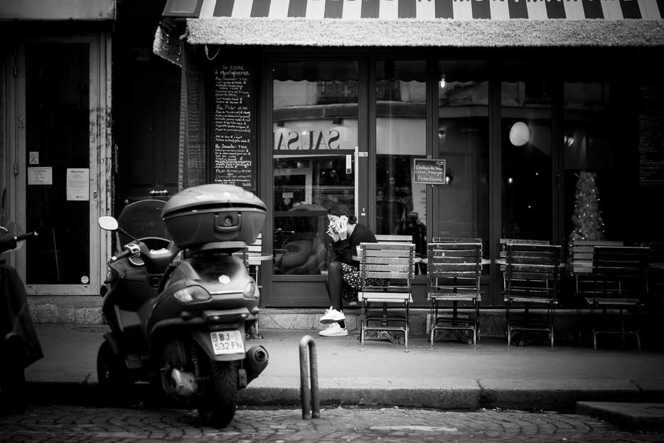 black and white street photography paris brasserie